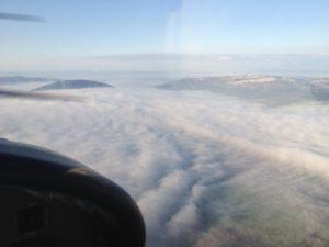 טיסה מעל הר תבור בעננים